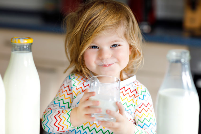 little girl drinking some milk
