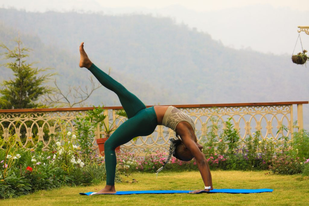 girl doing yoga on a open field