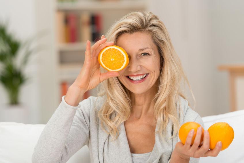 girl takin orange juice