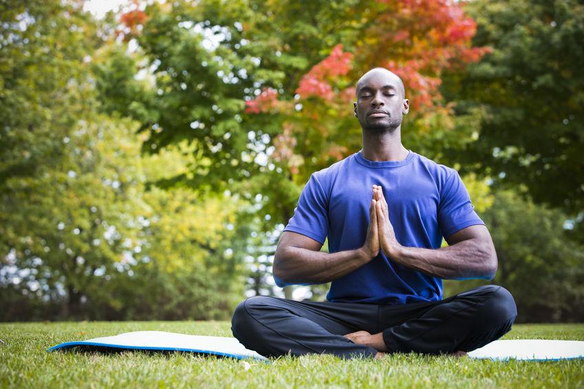 a guy doing yoga in the backyard
