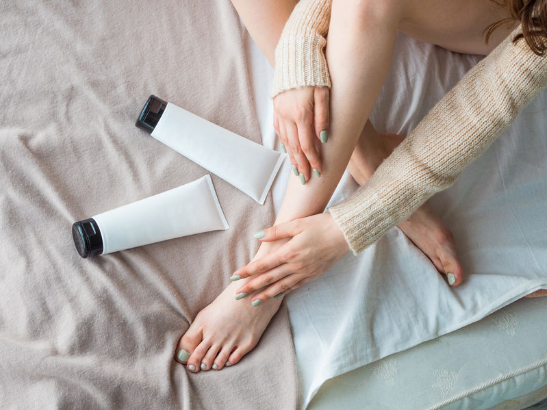 applying foot cream care