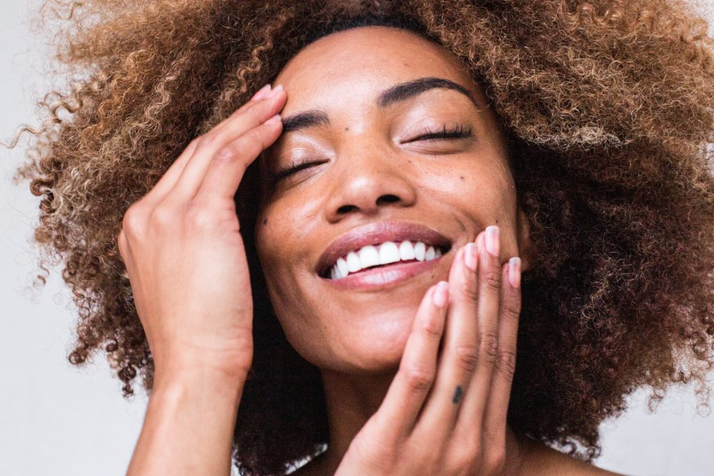 afro girl with skin care